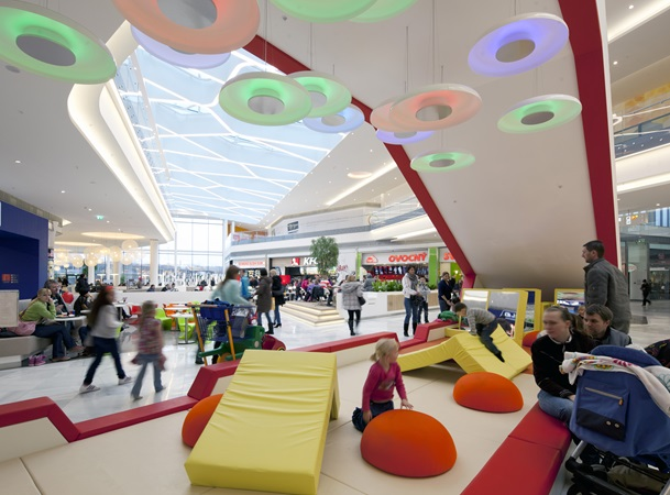 Children play at the shopping centre Centrum Černý Most
