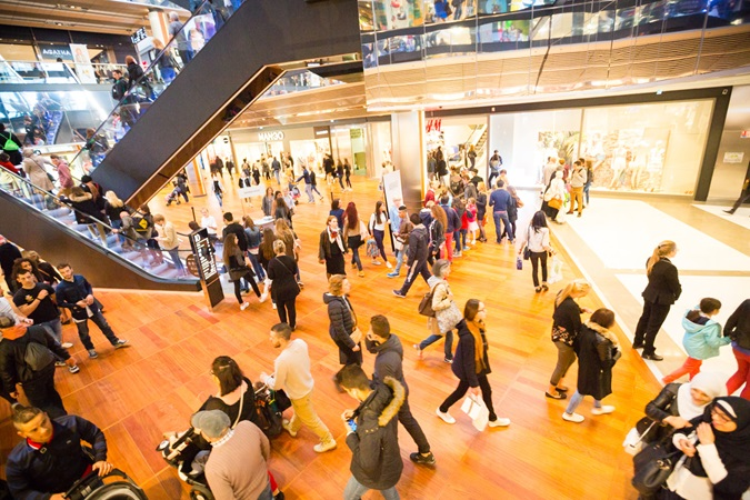 Customers stroll in the one the mall's shopping alleys in Euralille shopping centre