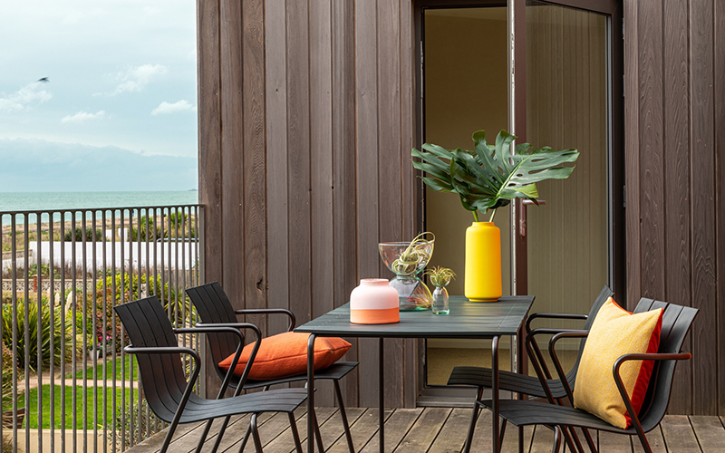 Dining table on balcony.